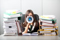 Business woman screaming with a megaphone in the office overworked Royalty Free Stock Image