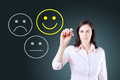 Business woman select happy on satisfaction evaluation. Blue background. Royalty Free Stock Photo