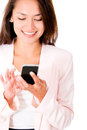Business woman sending a text message Royalty Free Stock Photo