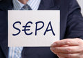 Business woman with sepa sign body and hand of businesswoman holding single euro payments area Stock Photo