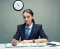 Business woman serious writing document Stock Photos