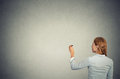 Business woman shot from behind writing on wall Royalty Free Stock Photo