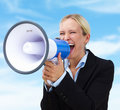 Business woman shouting through megaphone Stock Photos