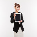 Business woman show empty space of pad PC Stock Images