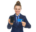 Business woman showing credit card and phone happy Stock Photo