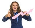 Business woman showing graph arrow going up and thumbs up smiling Stock Photos
