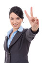 Business woman showing victory sign Stock Photos
