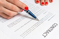 Business woman signing contract document in office Royalty Free Stock Photo