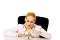 Business woman sitting behind the desk with house model Royalty Free Stock Photo