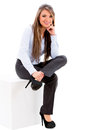 Business woman sitting on a box isolated over a white background Stock Photo