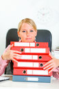 Business woman sitting at desk with folders Royalty Free Stock Photos