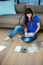 business woman sitting on the floor writing Royalty Free Stock Photo