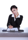 Business woman sitting on her desk holding a pen working with do documents sign up contract isolated white background Stock Photography