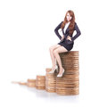 Business woman sitting on money stairs happy and look to you isolated against white background concept Royalty Free Stock Photo