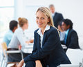 Business woman sitting with staff at the back Royalty Free Stock Photography