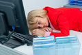 Business woman sleep on the office desk attractive blonde sleeping with head in Royalty Free Stock Image