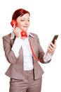 Business woman with smartphone and red phone receiver Royalty Free Stock Image