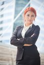 Business woman smiling arms crossed portrait of young asian standing and in modern city Stock Images