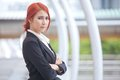 Business woman smiling arms crossed portrait of young asian standing and in modern city Stock Image