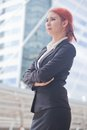 Business woman smiling arms crossed portrait of young asian standing and in modern city Stock Photos