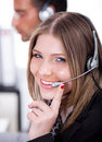 Business woman speaking through head phone Royalty Free Stock Photos