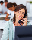Business woman speaking on the phone at work Stock Photography