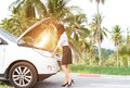 stock image of  Business woman standing by broken car