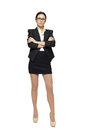 Business woman standing with folded hands Stock Photos