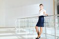 Business woman standing in the lobby of the office Royalty Free Stock Photo