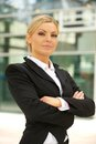 Business woman standing outdoors with arms crossed portrait of a beautiful Stock Photography