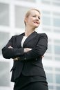 Business woman standing outside office building with arms crossed portrait of a successful Royalty Free Stock Photo