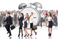 Business woman stands near big alarm clock Royalty Free Stock Photo