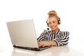 Business woman in stripy shirt in front of laptop in headset Royalty Free Stock Images