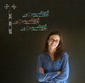 Business woman student or teacher arms folded with glasses formula racing car fan on blackboard background pen and note pad f cars Royalty Free Stock Image
