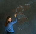 Business woman student teacher or politician with missile war map on blackboard background thinking about problems in north and Stock Photo