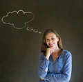 Business woman student or teacher with thought thinking chalk cloud on blackboard background arms folded with hand on chin Royalty Free Stock Photos
