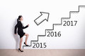 Business woman success in new year stepping up on stairs to gain her Royalty Free Stock Image