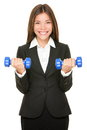 Business woman in suit lifting dumbbell weights Stock Photos