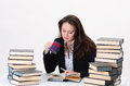Business woman surrounded by books in the office Royalty Free Stock Photos
