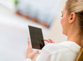 Business woman with tablet computer using app on a Royalty Free Stock Photography