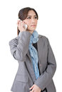 Business woman talk asian on cell phone with serious expression close up portrait on white background Stock Image