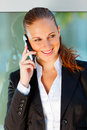 Business woman talking on mobile at office Stock Photo