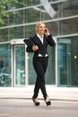 Business woman talking on mobile phone in the city portrait of a Royalty Free Stock Photo