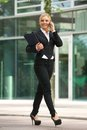 Business woman talking on mobile phone outside the office Royalty Free Stock Photo