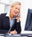 Business woman talking on telephone in office Royalty Free Stock Photos