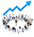 Business woman talking to business people and line graph above Stock Photography
