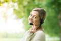Business woman talking using her headset in the park sony a Stock Photography