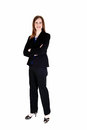 Business woman a tall slim young standing in a black suit from the front with her arms crossed isolated for white background Stock Photos