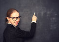 Business woman teacher with glasses and a suit with chalk the lost in thought at school board Royalty Free Stock Photos