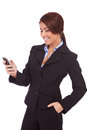 Business woman texting from her cellphone Stock Image